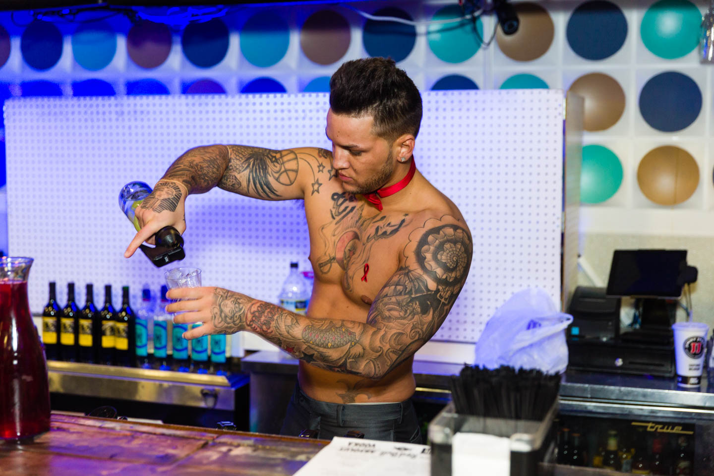 Shirtless tattooed bartenders