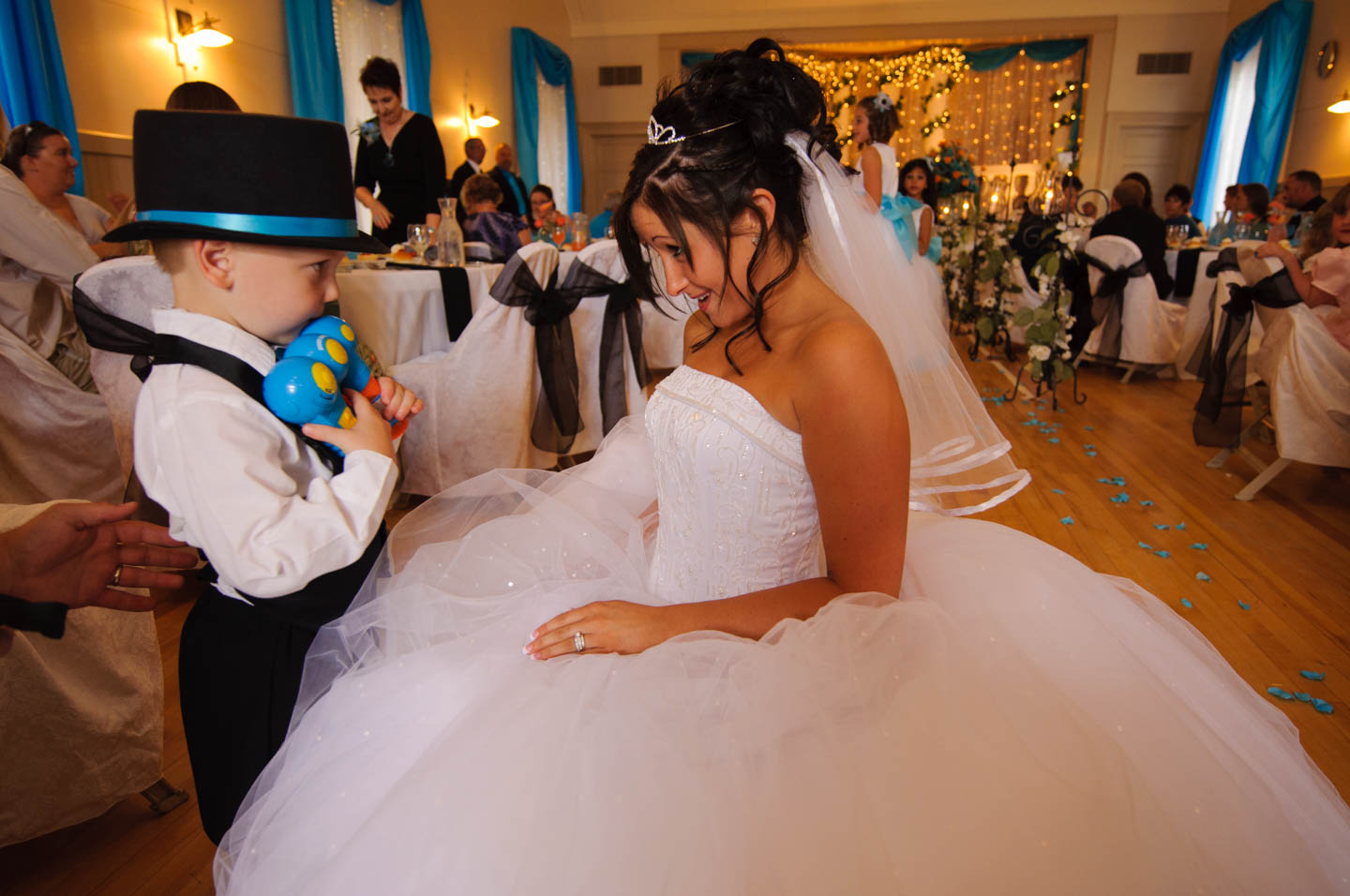 Bride talks bubbles with one of the ring bearers