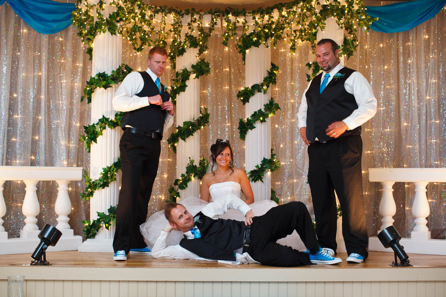 Bride with the big groomsmen