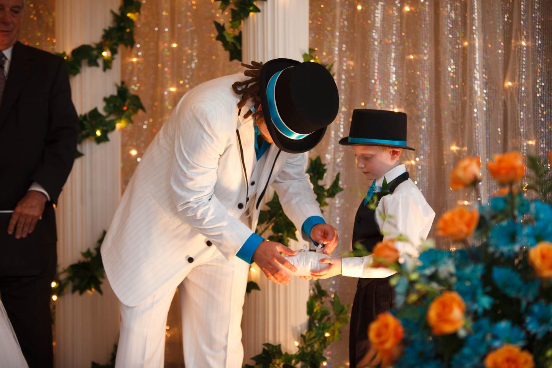 Groom retrieves the wedding rings