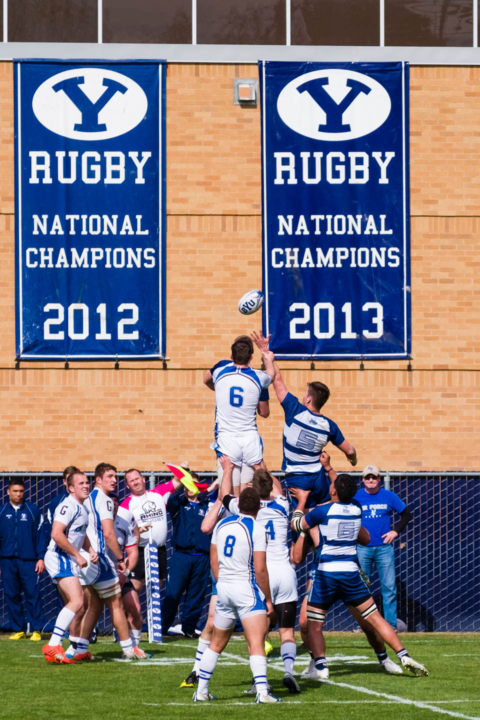A line-out in front of the championship banners
