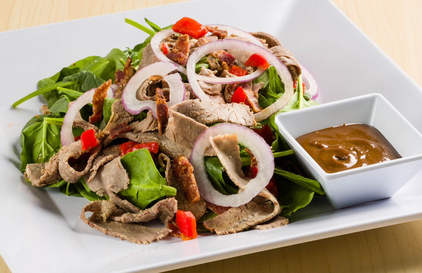 Beef and onion spinach salad