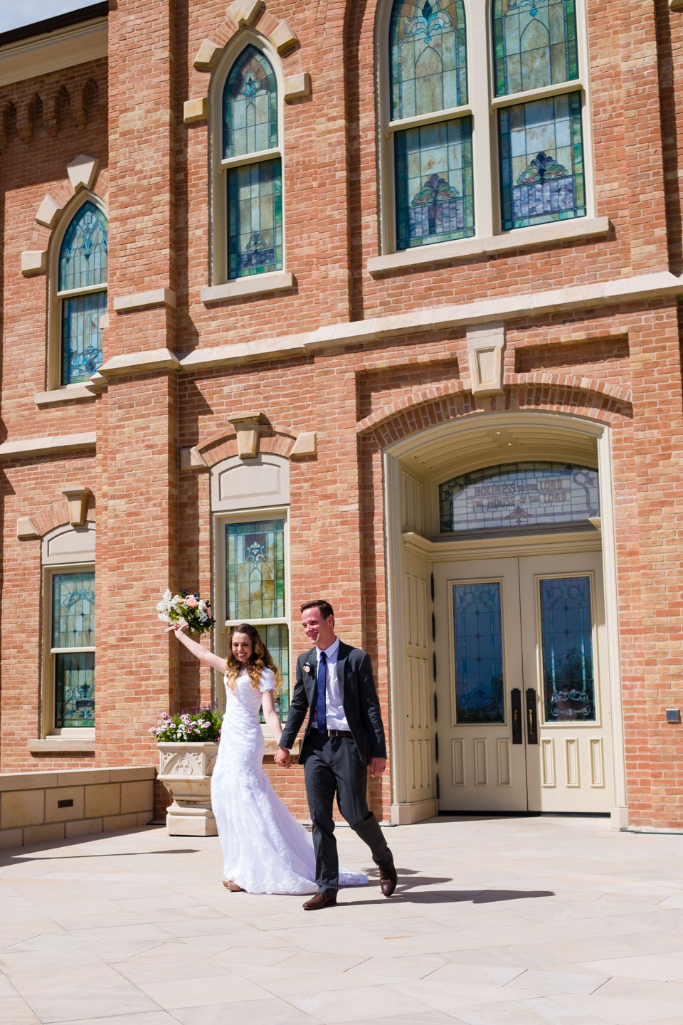 The bride and groom leave the Provo City Center Temple