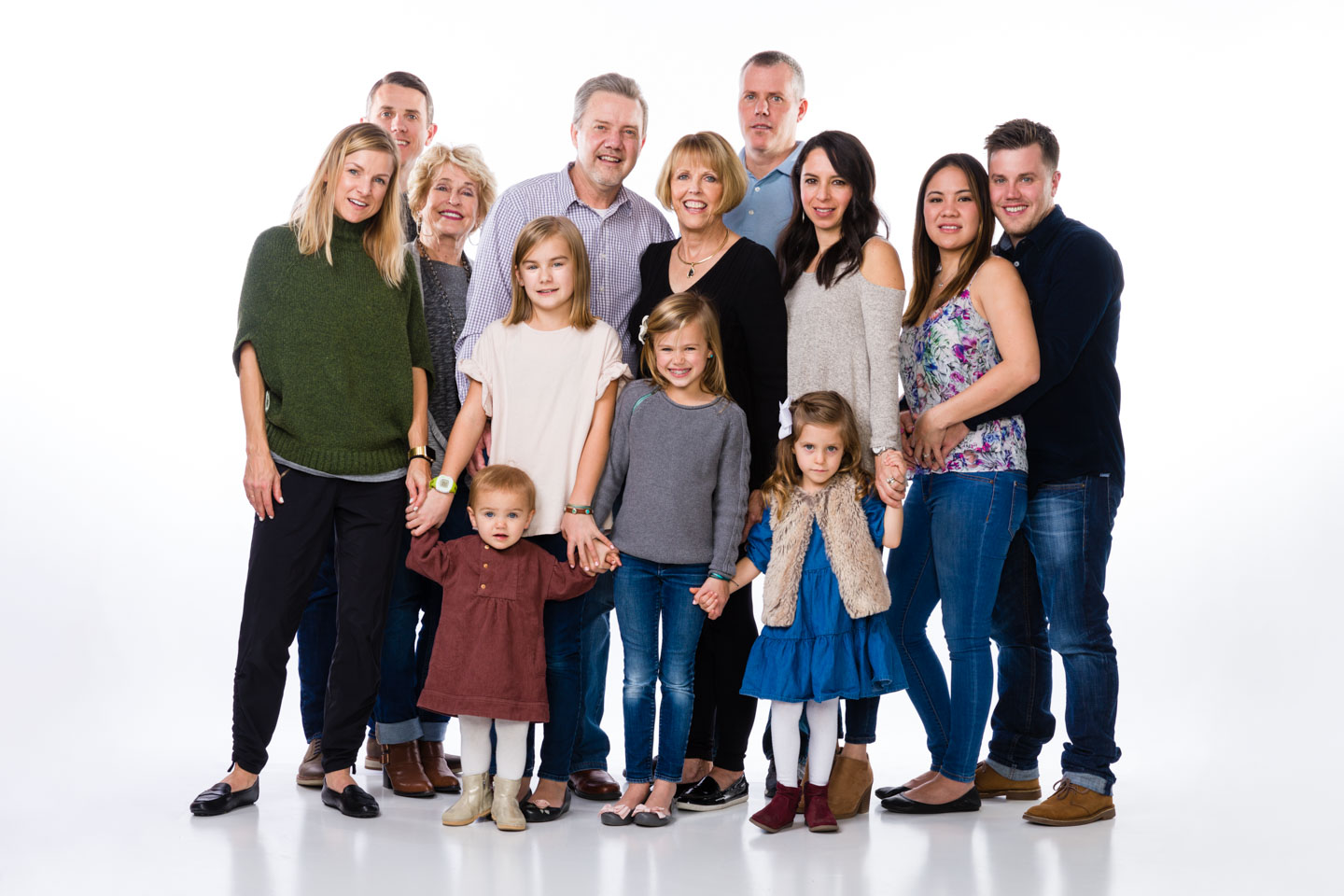 The whole family in front of a white background