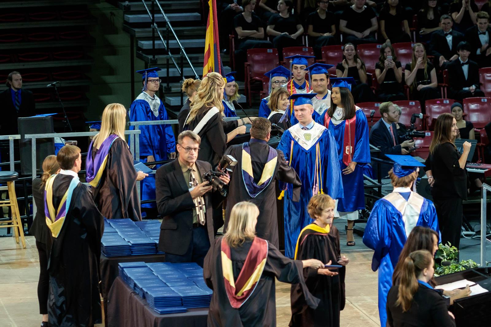 Matthew receives his diploma