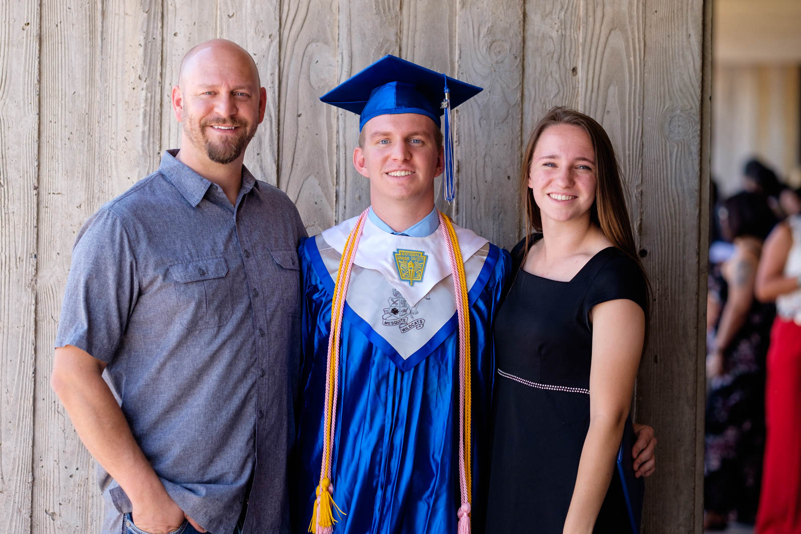 Matthew with his dad and sister