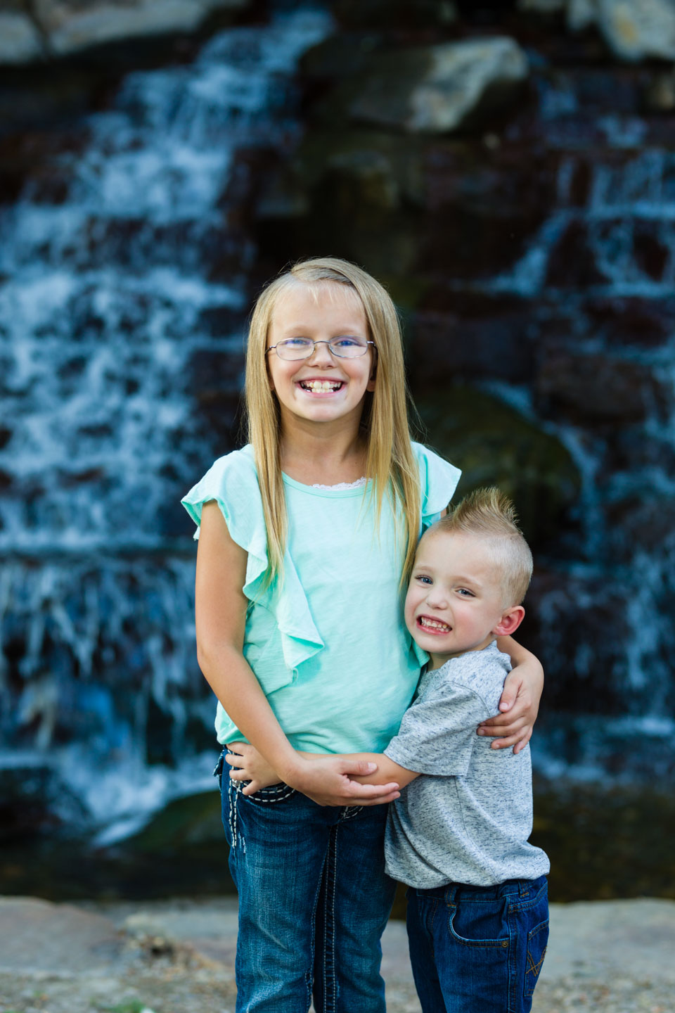 Brother and sister and a mini waterfall