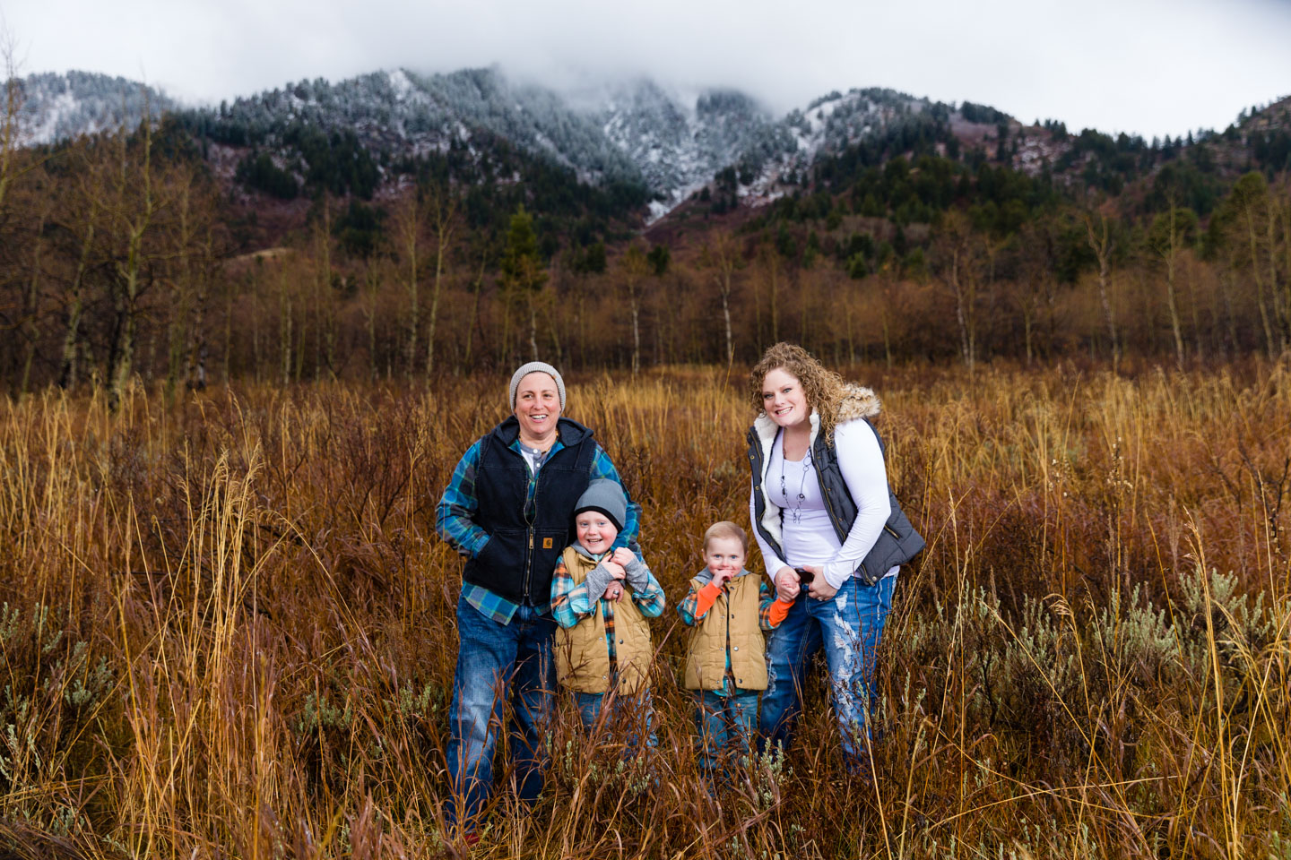 Snowcapped mountains in then background with the feel of autumn for family photos
