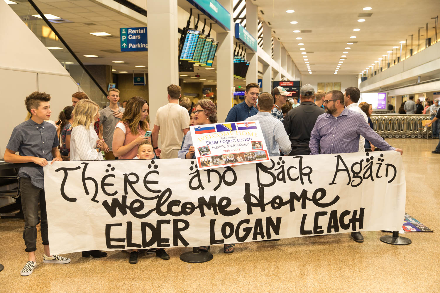 People gather at the SLC International Airport to welcome missionaries