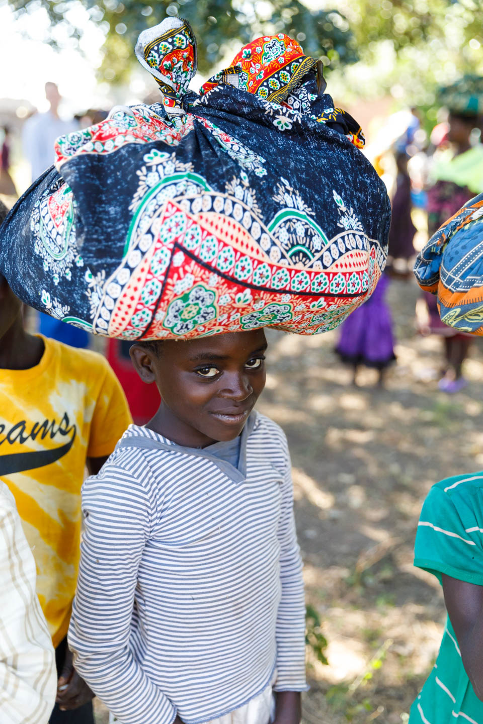 A Malawian child with a bundle on her head