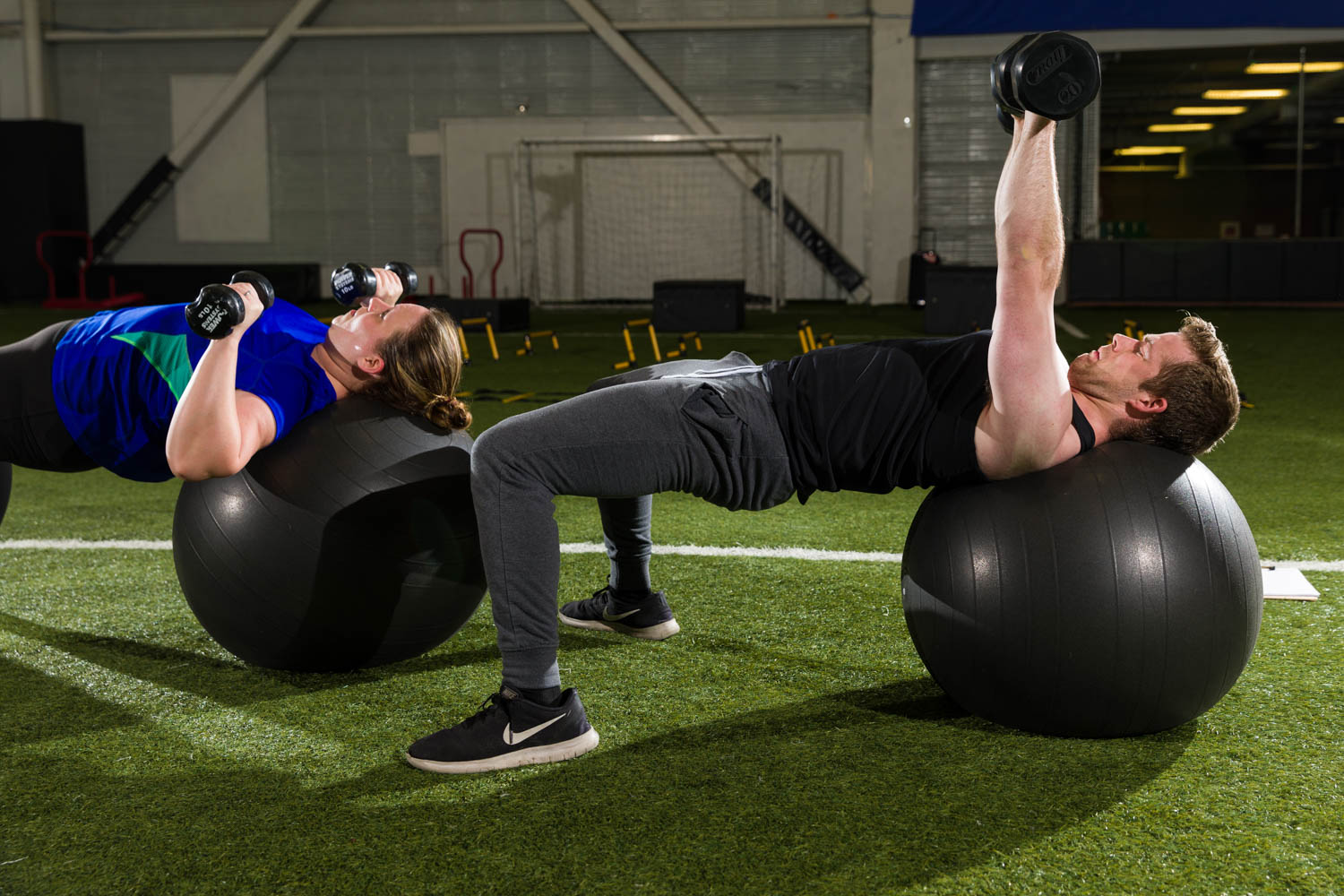 Working with inflatable balls and free weights