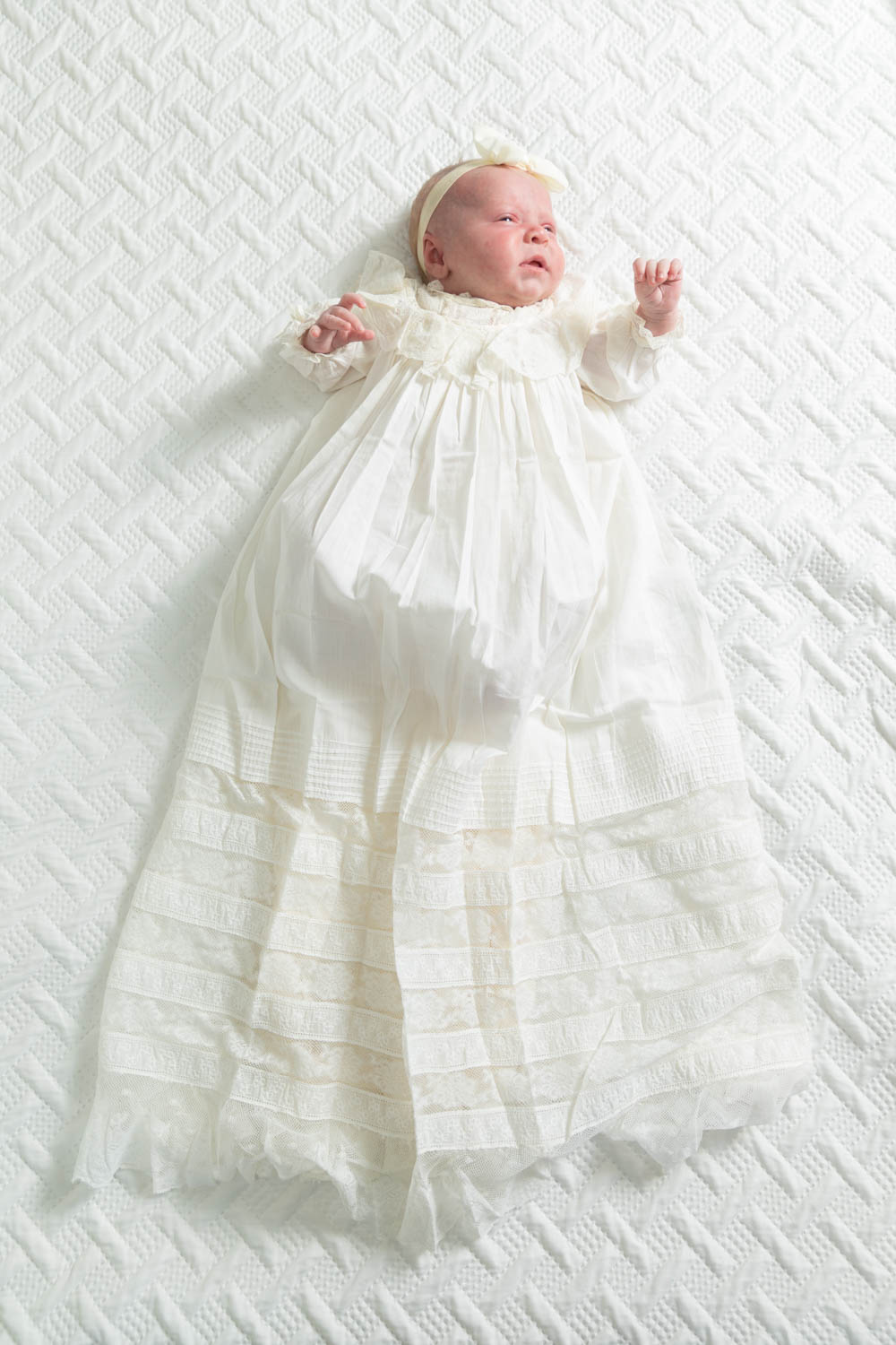Ainsley in her baby dress. The dress is more than 113 years old.