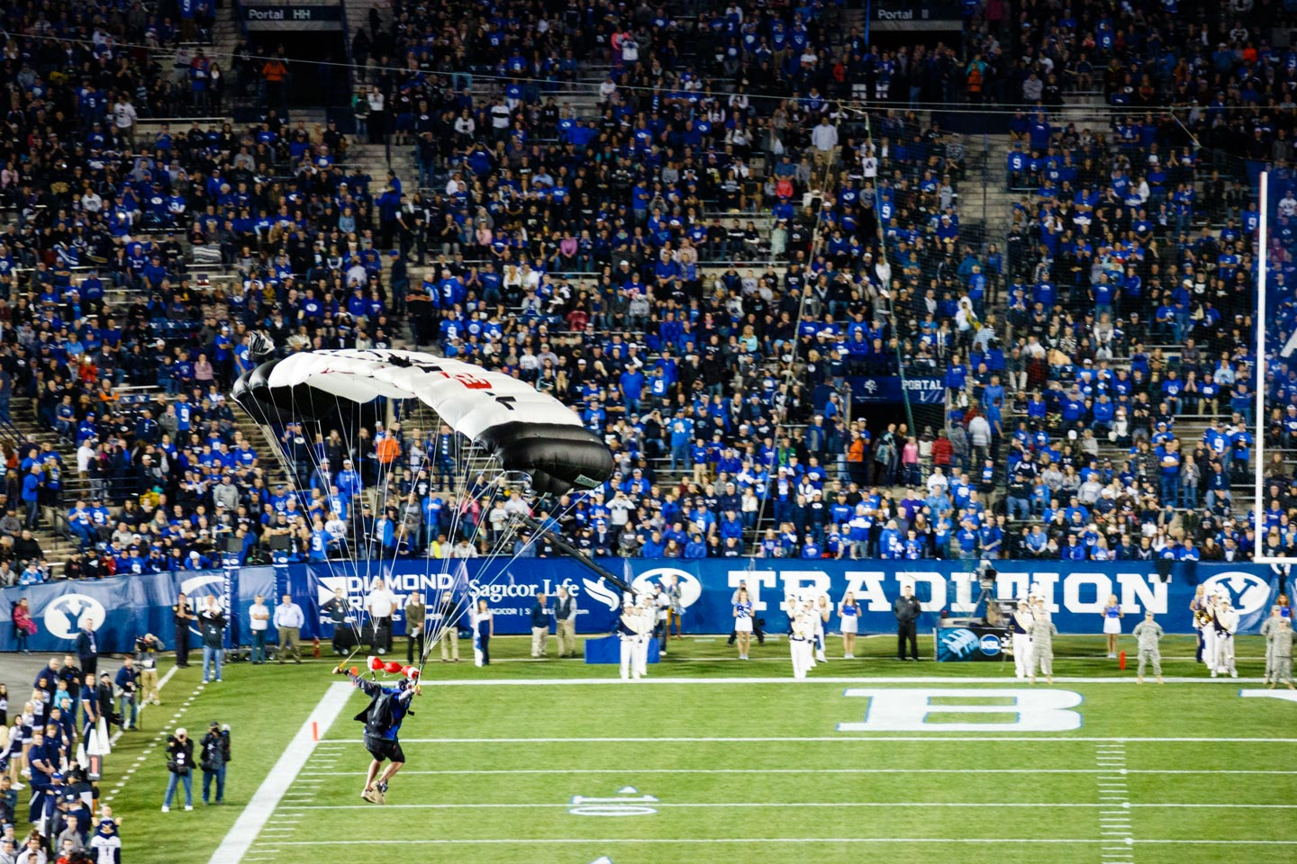 Parachuter lands in Lavell Edwards Stadium