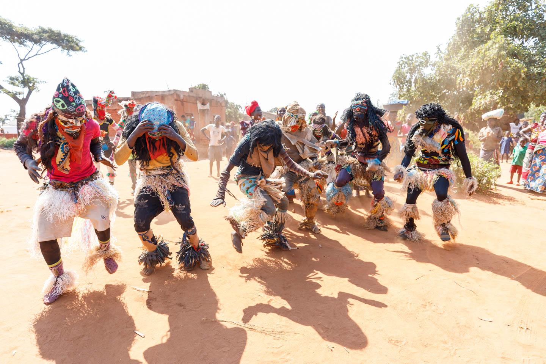 Masked dancers perform