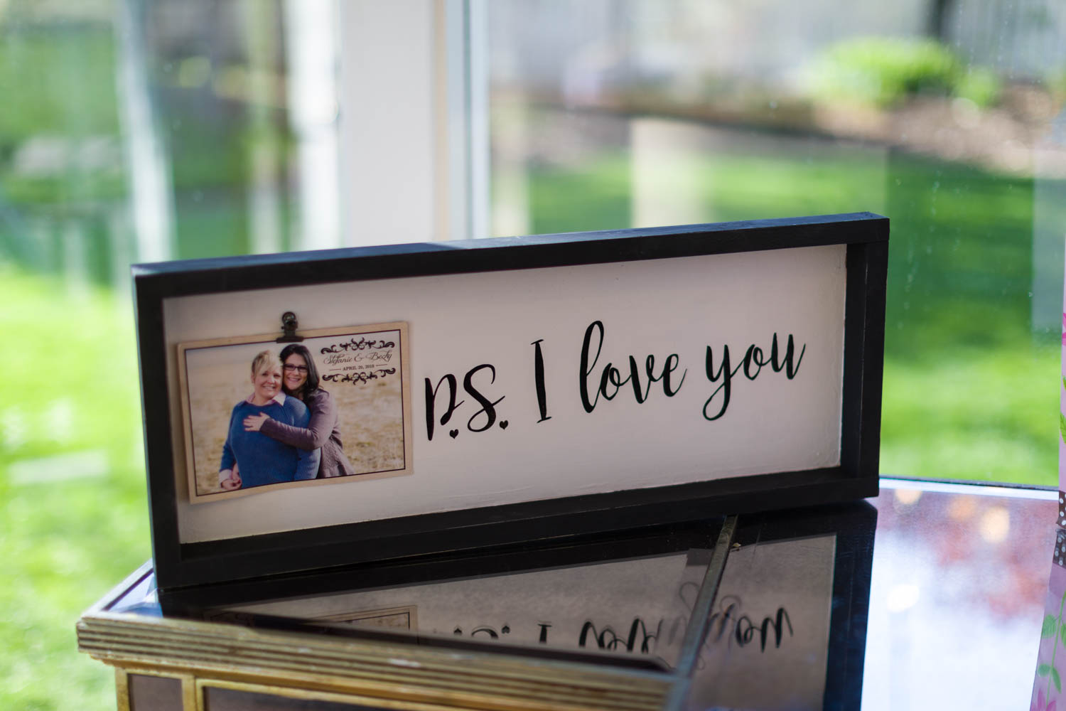Signage with engagement photos