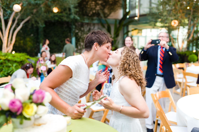 Kiss after cutting wedding cake
