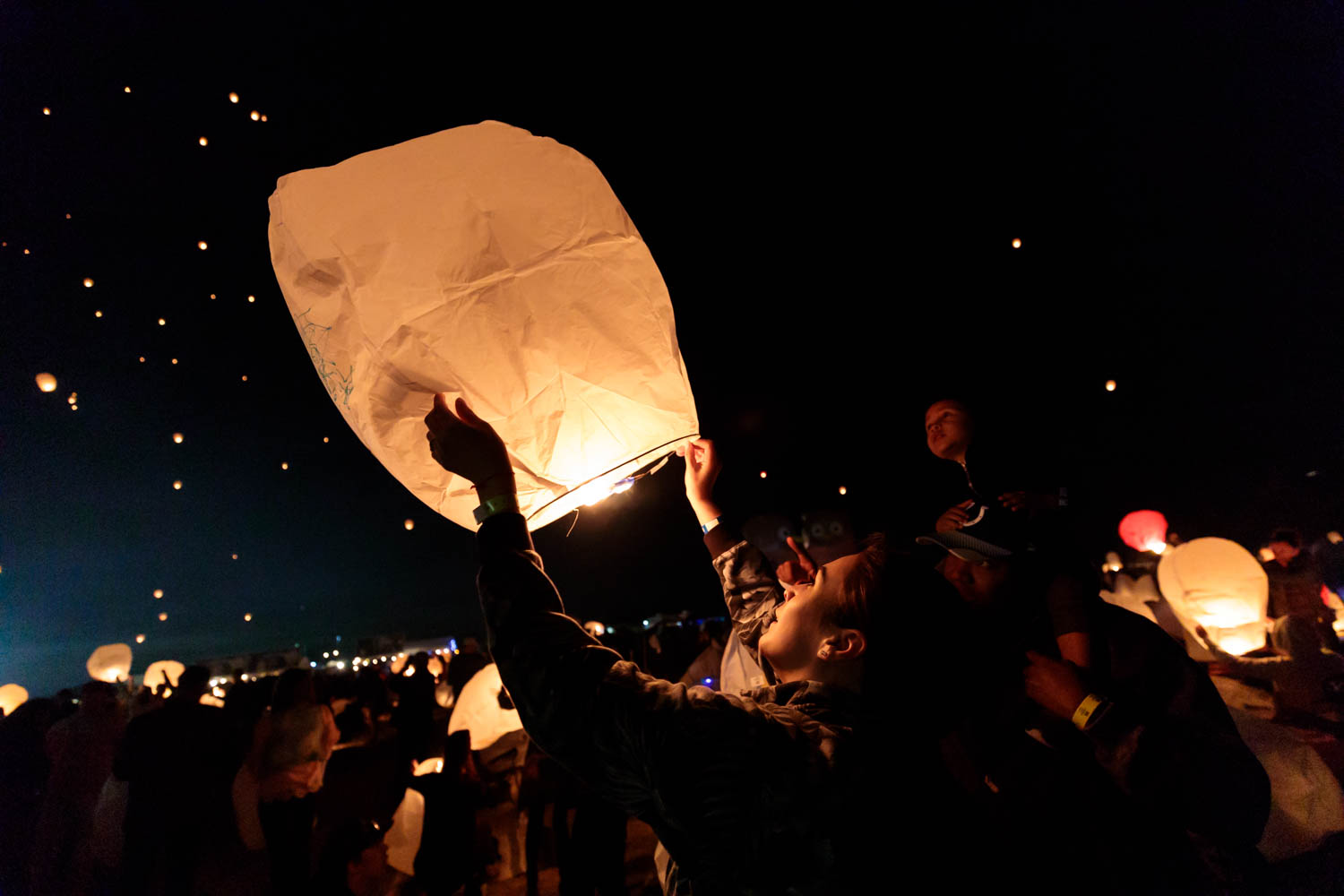 Releasing the lantern into the night
