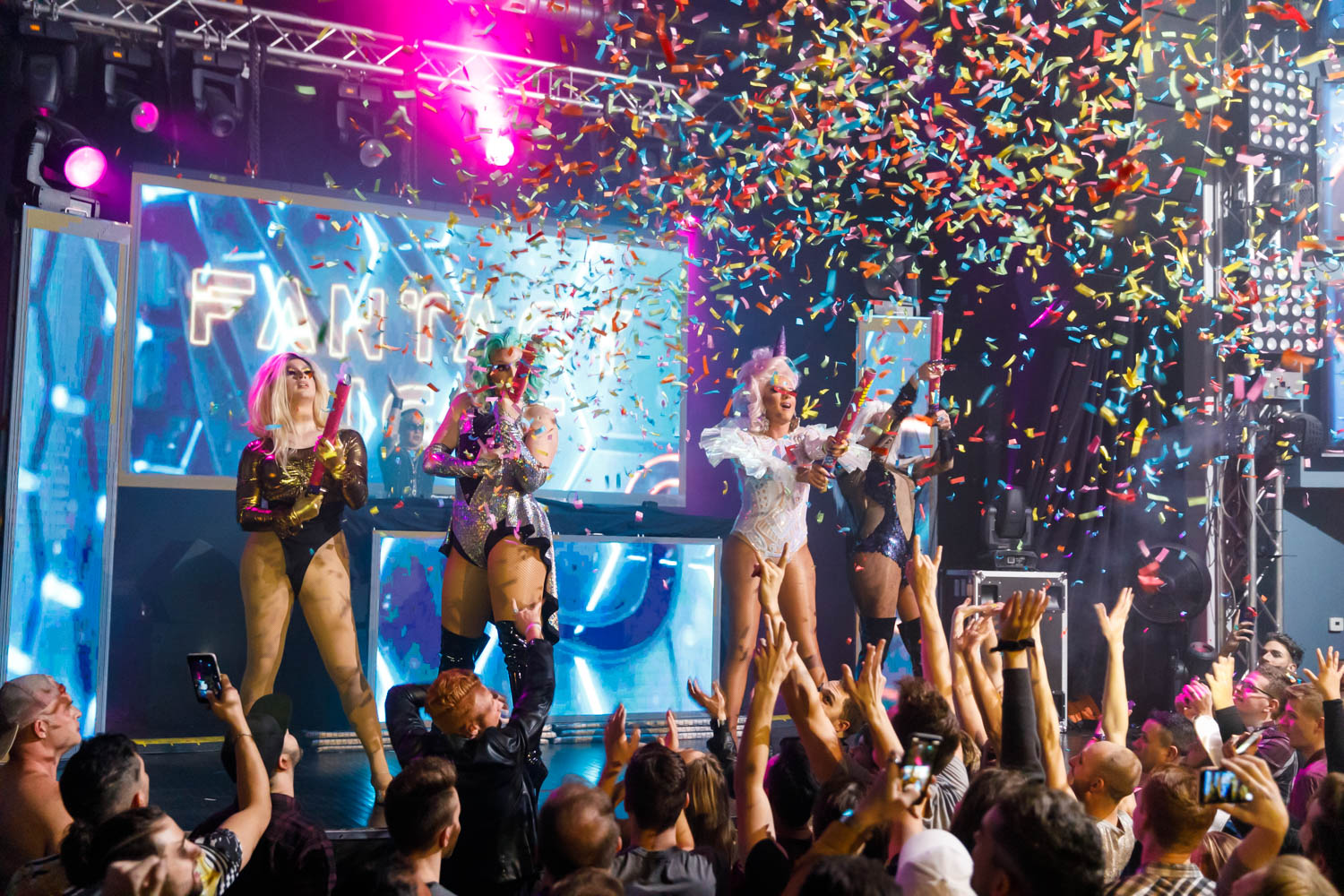 Drag queens shoot confetti