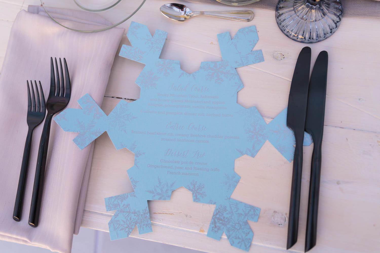 A silver and blue snowflake menu