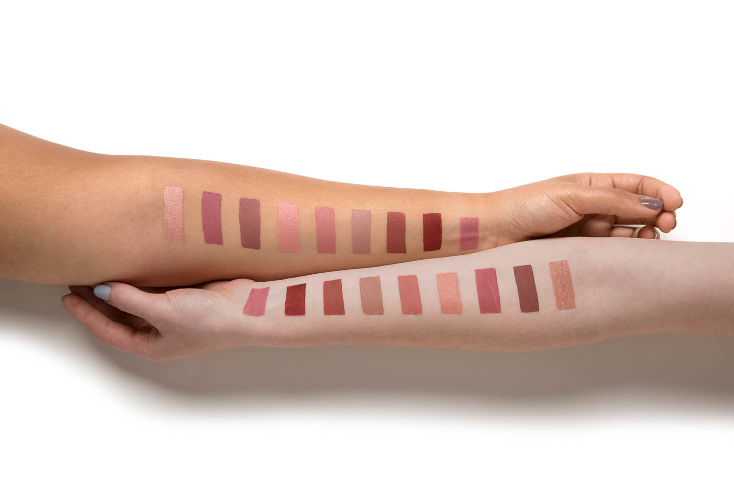 Arm swatches show the different POWERLips Fluid