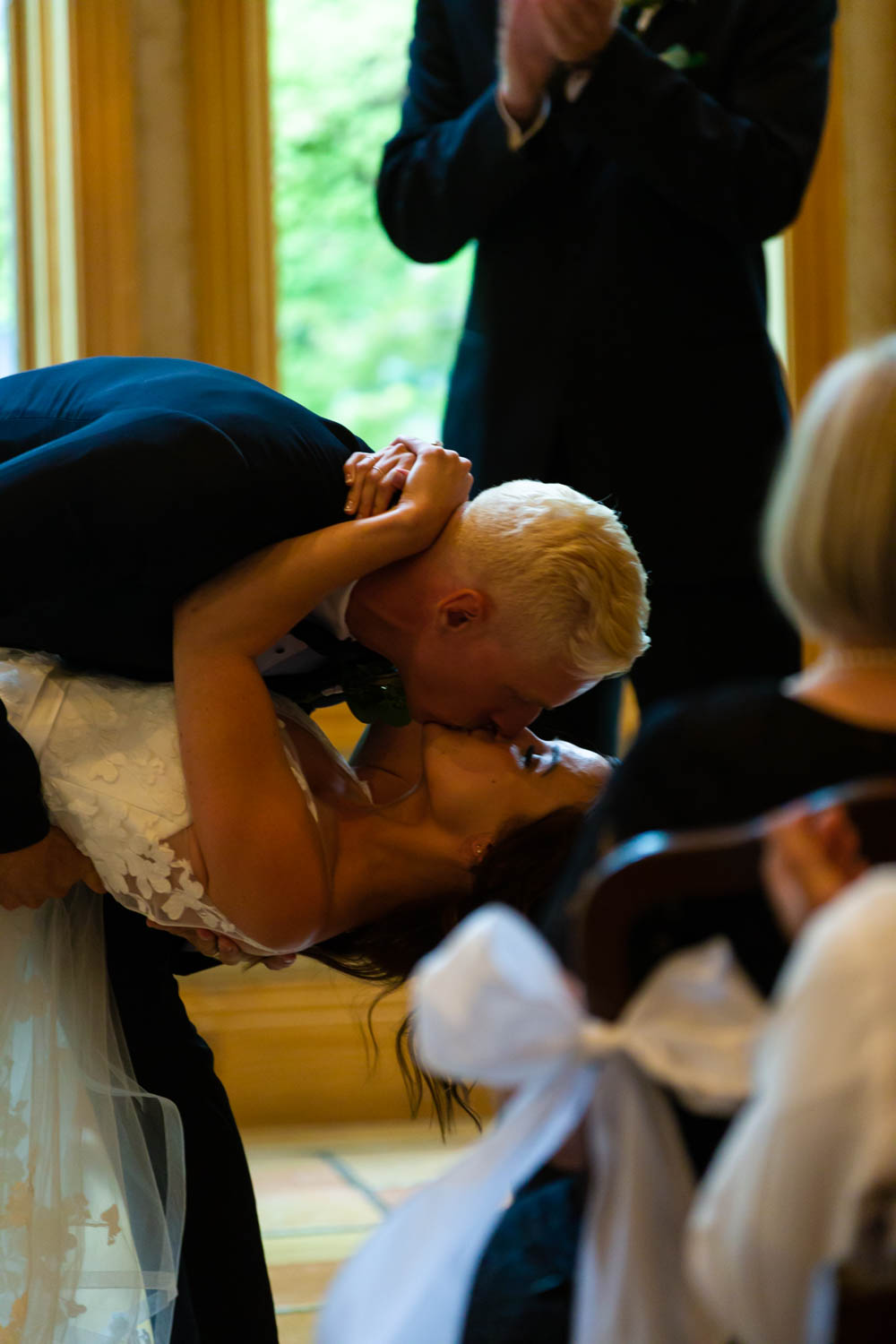 Bride is dipped during the first kiss
