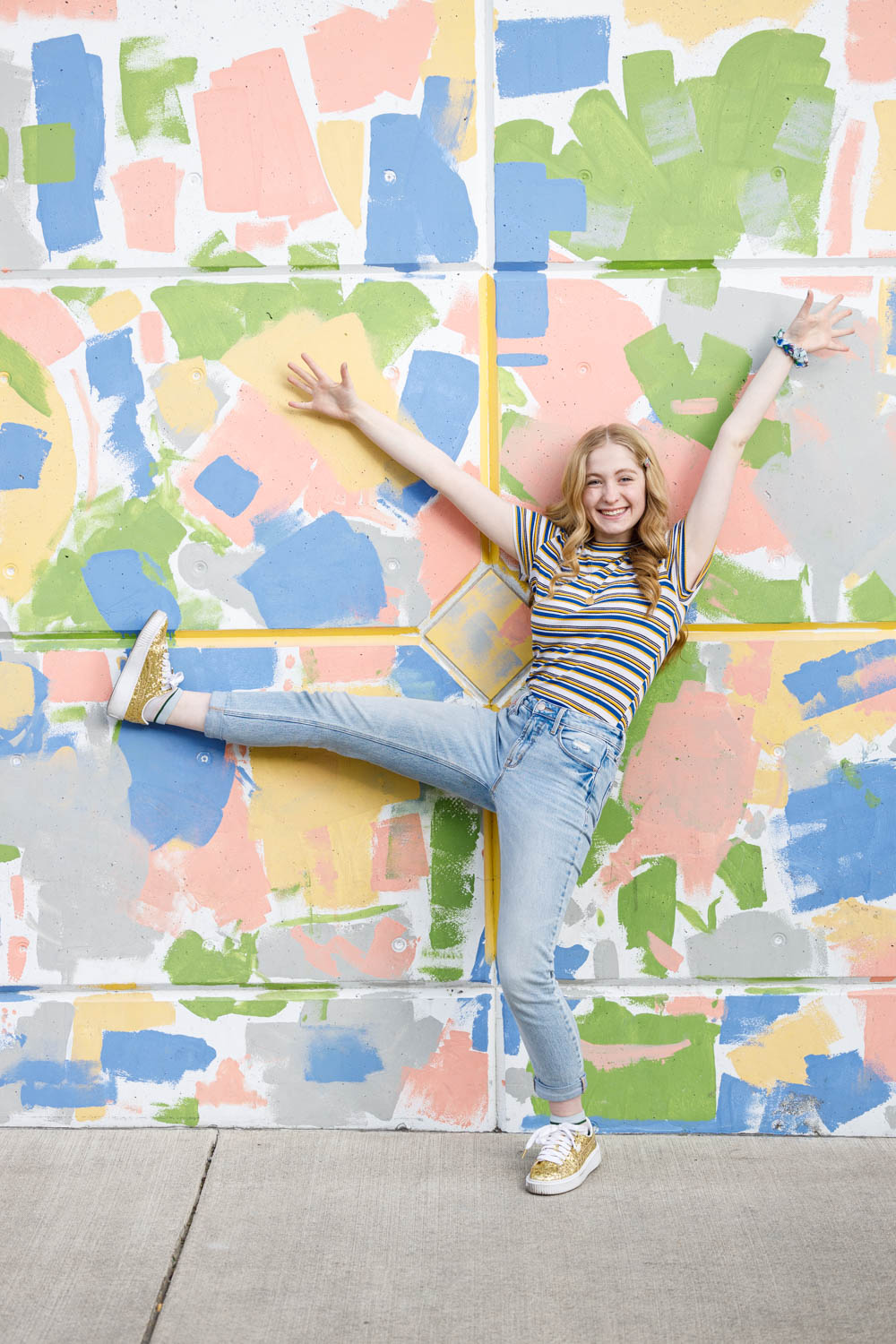 Graffiti backdrop with a fun pose