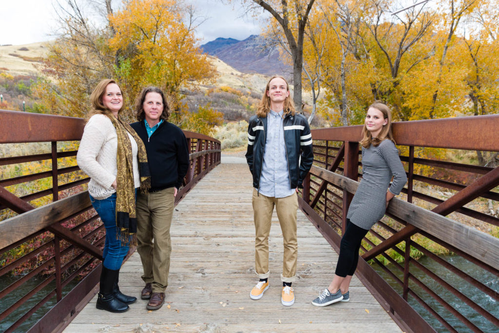 Family on a bridge in autumn